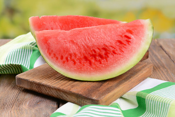Juicy watermelon on table on bright background