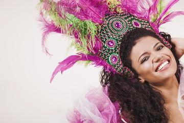 Samba dancer wearing pink costume and smiling