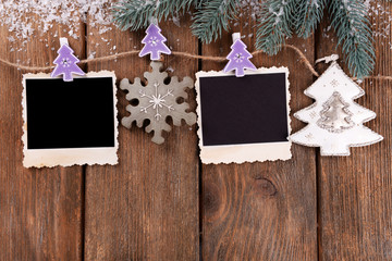 Blank photo frames and Christmas decor with snow fir tree