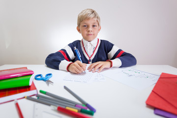 Schoolchild at the sweater doing wordsearch
