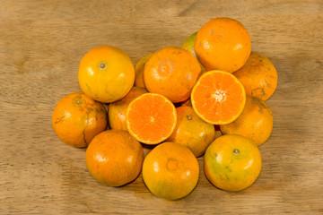Oranges Fruit on  rubber wood background