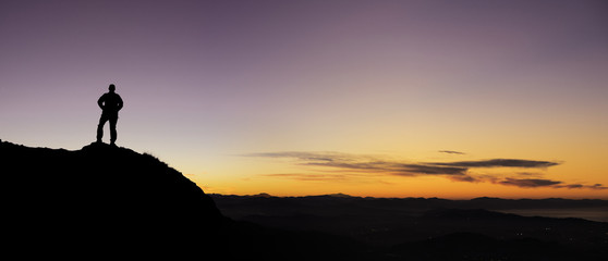 A man playing sports in the mountains at sunset, Euskadi