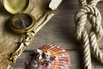 Old compass, rope and shell
