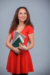 Young attractive girl in red with folders