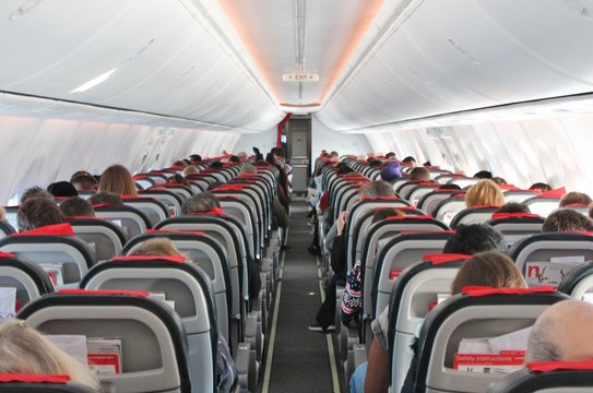 coronavirus airplane planes travel ban grounded concept - airplane cabin aircraft seats people plane air travel background copy space stock photo stock photograph, image, picture,
