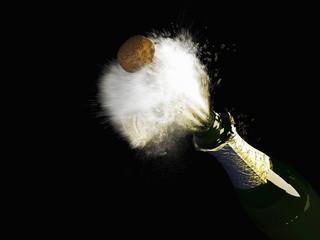Celebration theme with splashing champagne, isolated on black