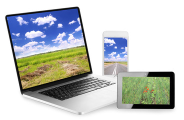 Laptop, tablet and phone with nature wallpaper