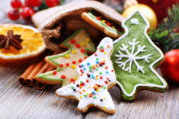 Gingerbread cookies with slices of orange, cinnamon and star