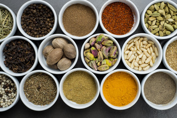 large collection of different spices and herbs isolated on Black