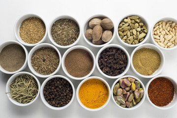large collection of different spices and herbs isolated on white
