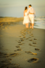 Couple footprints in the beach sand