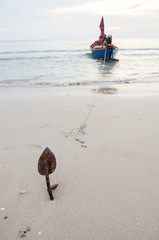 Fishing boat with anchor