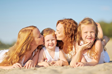 family portrait of mother and of a boy and his two sisters loved