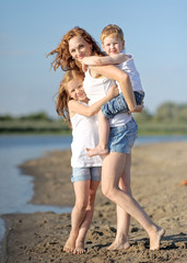 Mom with son and daughter in summer nature