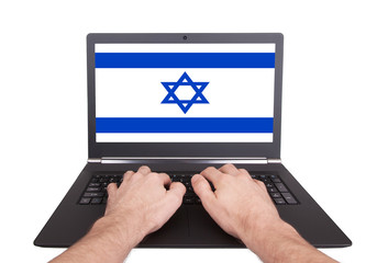 Hands working on laptop, Israel
