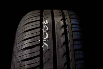 Car tires close-up on black background