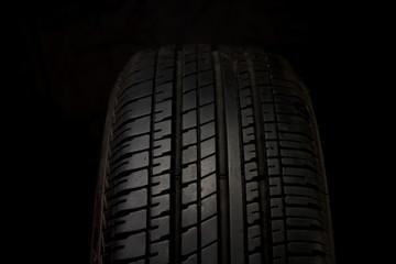Car tires close-up on black background