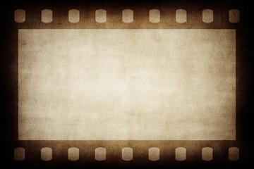Grunge brown film strip background.