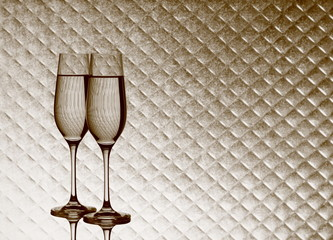 Champagne glasses on blurred checkered background