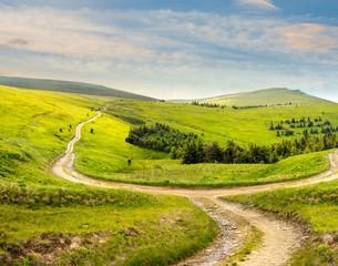 cross road on hillside meadow in mountain at sunrise
