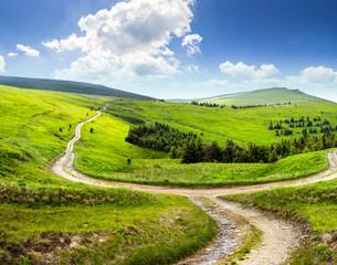 cross road on hillside meadow in mountain