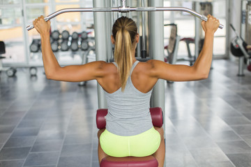 Pretty young woman training in the gym