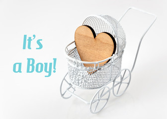 Baby card - Its a boy theme. Pram with wooden heart on white