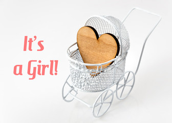 Baby card - Its a girl theme. Pram with wooden heart on white