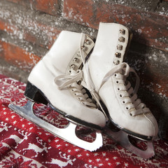 Christmas. Skates on artificial snow