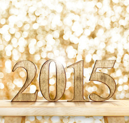 2015 year number on wooden table with sparkling bokeh