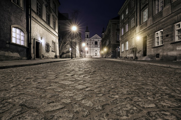 The street of the old town in Warsaw at night