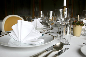Fine dining table, plate wine glasses and cutlery