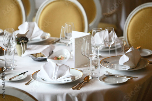 Restaurant set up, fine dining tables, plates and glasses\
