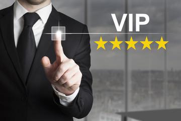 businessman pushing button vip five gold stars