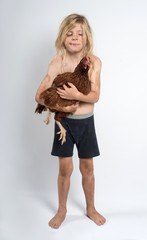 Boy looking at a chicken