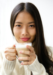 Beautiful young asian woman smiling with cup of coffee