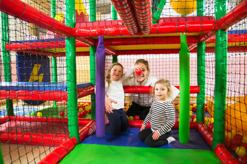 Mom and daughters in indoor playroom