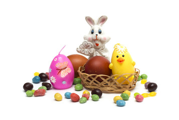 Happy Easter. Rabbit with Easter eggs and candies.