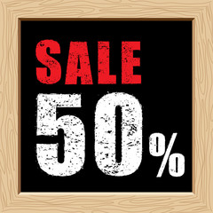 Rubber stamp of sale 50% off on black board vector