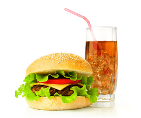 Big hamburger and cola with ice cubes