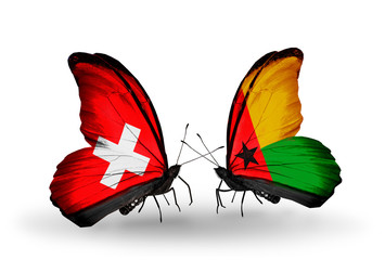 Two butterflies with flags Switzerland and Guinea Bissau