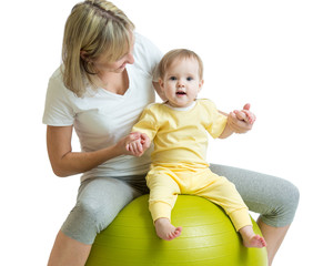 child and mother with fitness ball