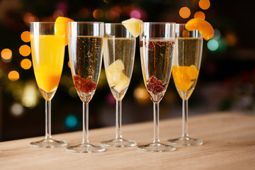 Five glasses of champagne with fruit