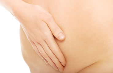 Close up on woman massaging slim belly