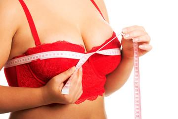 Fat woman measuring breast