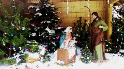 Christmas Manger scene with figurines including Jesus, Mary