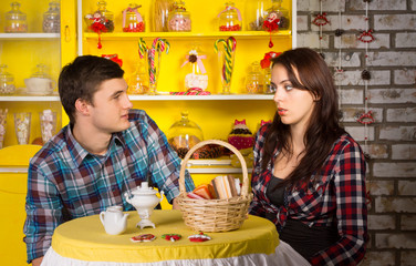 Couple Looking Each Other at the Snack Bar