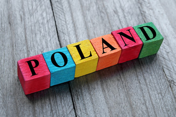 word poland on colorful wooden cubes
