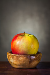 Apple in a Wooden Bowl