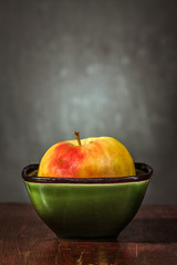 Apple in a Green Bowl